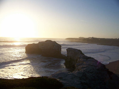 sunset view of bridge at Natural Bridges State Beach