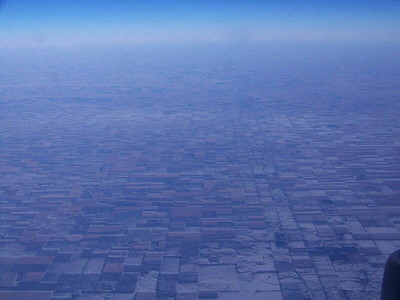 snowy farm fields in Kansas, from the air