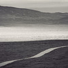 Ribbon of the road through the bottom of the Carrizo Plain valley.