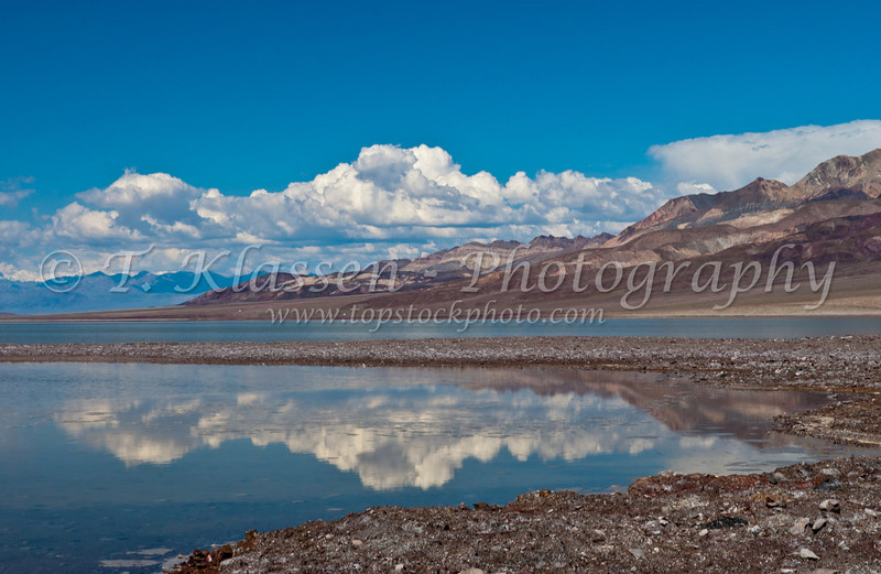 Mountains surrounding Death Valley reflected in Badwater lake, California, USA.