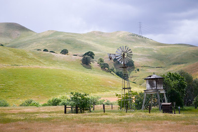 143 - Black Diamond Mines, Antioch, CA  I liked the contrast between the power lines on the horizon, and the old windmill, a juxtaposition of past and present in one plane, of man's ingenuity constantly striving to create, to improve, to move forward.    Yet the old is not entirely relinquished.... it stands as a reminder that simplicity is an adornment, an artwork, a remnant of the people of our past.   It is in this way I understand the Native American reverence for ancestors and Holy Grounds, how some things should be left standing and not defiled.   (EBRP-Black Diamond Mines)