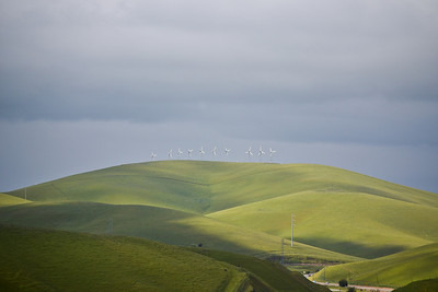 119 - Altamont Pass Hills, Route 580 in right foreground.   The simplicity of this appeals to me.   Uncluttered by development, just a touch of human inventiveness scallops the ridgeline, an understated adornment that man is here, but nature is the dominant force in the scene.   The hubris of man is checked in such compositions of scale, of efficacy, of endurance. (EBRP-Del Valle)
