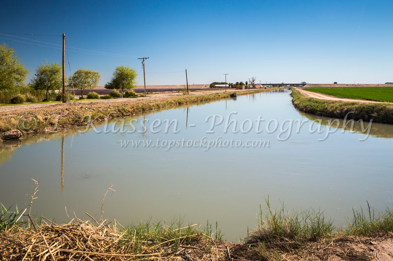 Agricultural irrigation canals and control facilities in the Imperial Valley of California, USA.