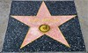 "Since he's nearby, ""Heeeere's Elvis!"". This is not Elvis's original star. It was damaged and removed after 50 years at another location. That star was one of the 8 placed on the first day of the Walk of Fame, February 9, 1960. It was at 6777 Hollywood Boulevard. This is the newer one."