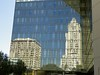 City Hall Tower and Hall of Justice reflected in the L.A.P.D. building