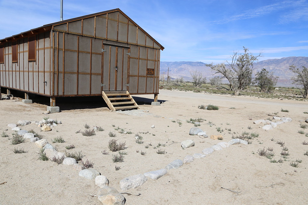 Manzanar barracks measured 120X20 feet and were divided into six one-room apartments, ranging in size form 320 to 480 square feet. Each block of 15 barracks shared bath, latrine, and mess buildings.