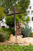 A statue and religious icon in the courtyard of the Mission Basilica San Diego de Alcala near San Diego, California, USA.