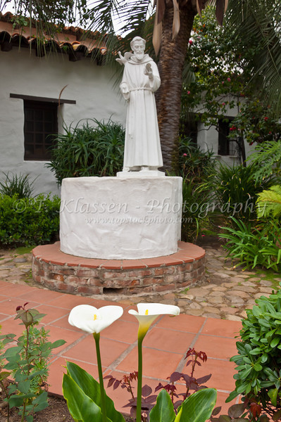 A statue of a Saint and religious icon in the courtyard of the Mission Basilica San Diego de Alcala near San Diego, California, USA.