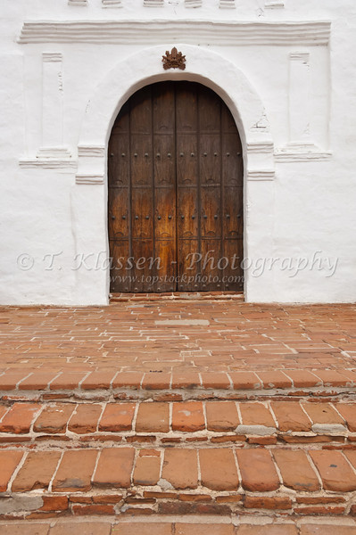 The wooden exterior front door at the Mission Basilica San Diego de Alcala near San Diego, California, USA.