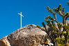 A white cross on a rock pile in the Mojave Desert, California, USA.