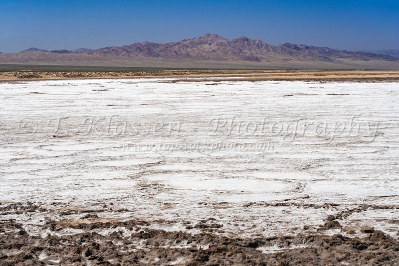 The Bristol Dry Lake salt accumulation on Route 66, near Amboy, California, USA.