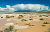 Desert rain storms in the mountains with dry washes and washes flowing with flash flood waters in the Mojave Desert, California, USA.