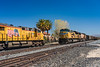 A freight train at a crossing in the Mojave Desert, California, USA.