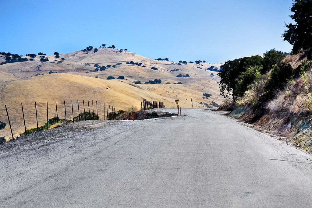 """Mendenhall Road, Livermore.   That """"hole"""" on the left of the road has been there for years."""