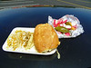 One pollo taco, one carnitas taco, one queso torta