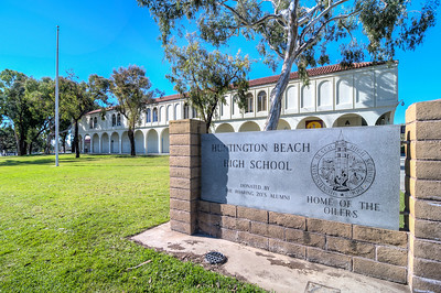 "Huntington Beach High School's founding was one of uncertainty and political opposition. Originally known as Las Bolsas High School, the school opened in Los Alamitos in 1902 and served as a secondary school for Westminster, Garden Grove, Los Alamitos, Bolsa, New Hope, Fountain Valley, Chica, Ocean View and Springdale elementary districts. However, after only one student showed up for class, the site was scrapped four days after its opening. After attempts to find a permanent location failed due to political opposition and controversy, the remaining districts of Ocean View, Springdale and Fountain Valley were joined by those of Huntington Beach and Newport Elementary.  In 1906, the ""school on wheels,"" as it was often called because of its inability to secure a permanent location, finally settled in Huntington Beach and began operation as Huntington Beach Union High School. Classes were initially held in the basement of an auditorium operated by the local Methodist church. Having received a land grant from the Huntington Beach Company, the high school completed construction of its first permanent buildings at its current location in 1908. By 1910, there were seven teachers and three clubs; Huntington Beach had a population of 815 people. By this time the four graduates had become an average of 14 graduates a year. The first graduating class consisted of six students, but expanded rapidly in the next decade into the hundreds.  In 1921, the Huntington Beach Company increased mining in abundant oil fields around the city bringing a wave of prosperity to the area. In 1926, the school's architects, Allison & Allison, a Santa Ana firm, described the school's structure as a Lombard Romanesque Revival. The iconic bell tower and auditorium were the first buildings constructed, and seven other buildings were built between 1926 and 1952.  In the 1970s, Huntington Beach High School began construction of new facilities for a variety of reasons, the most prevalent was the earthquake on February 9, 1971. Some older buildings were demolished and rebuilt because of damage.  Huntington Beach High School is known for its bell tower and auditorium. They were originally built in 1903 and were rebuilt in 1926.  In July 2009, renovations were completed on the 27,000 square-foot, 600- seat Darrel Stillwagon auditorium and the bell tower. Construction was also completed on the school's new 9,200-square-foot performing arts classrooms building and courtyard. The project was funded through the HBHSUSD modernization and expansion program."