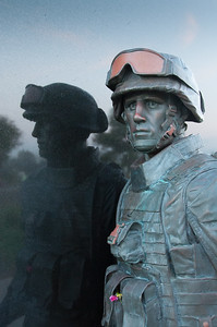 "According to the City of Newport Beach, The 1st Battalion, 1st Marines (1/1) hold a special place in the hearts of residents.  On Memorial Day, May 26, 2008, the community dedicated a memorial in honor of the Marines of 1/1. The memorial, designed by artist Benjamin Victor, is a bronze sculpture set against a black granite backdrop. It represents a young Marine in battle dress, walking forward while looking back. The relationship between the City and 1/1 began in 2003 when the City ""adopted"" 1/1 to assist these Marines and their families. 1/1 is a decorated Marine unit that first saw action in World War II and recently returned from its third deployment to Iraq."