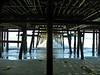 Centered under the pier