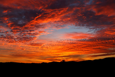 Colorful clouds over the valley put on a dramatic display at sunset
