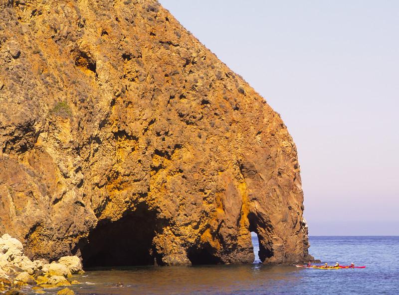 Santa Cruz Island, Channel Islands, Kayakers approaching caves