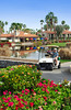 Golfers and a golf cart at the Rancho Las Palmas Marriott Resort in Palm Desert, California, USA.