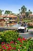 Golfers and a golf cart at the Rancho Las Palmas Marriott Resort in Palm Desert, California, USA.