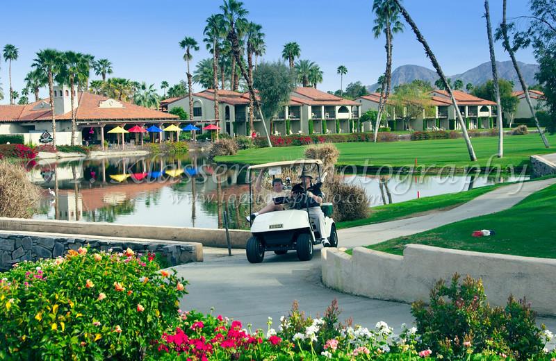 Golfers in a golf cart at the Rancho Las Palmas Marriott Resort in Palm Desert, California, USA.