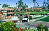 Golfers in a golf cart at the Rancho Las Palmas Marriott Resort in Palm Desert, California, USA.