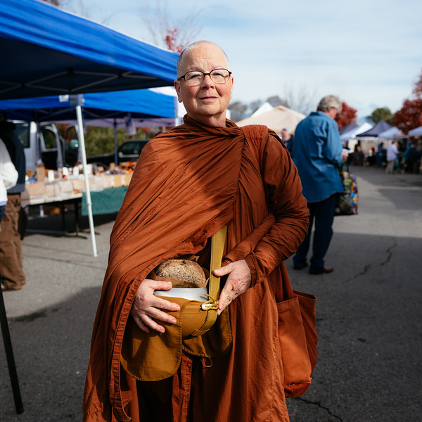 Thai forest tradition nun at Petaluma Eastside Farmers Market. Petaluma, Ca.