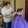Friend cutting friend's hair