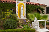 Religious icons in a small garden outside the Immaculate Conception Church in Old Town, San Diego, California, USA.