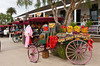 An Old Town Market sign and wagon with colorful fruit in Old Town, San Diego, California, USA.