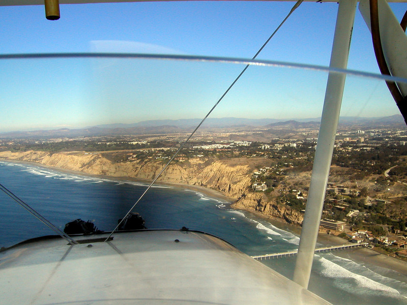 Torrey Pines, Blacks Beach, La Jolla scripts pier, 1930s TravelAir Biplane flight around San Diego,
