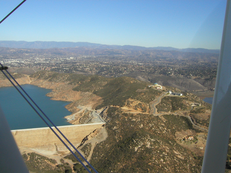 The new Olivenhain  Reservoir near Lake Hodges, 1930s TravelAir Biplane flight around San Diego