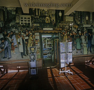The depression era Works Progress Murals, including some by Victor Arnautoff, in San Francisco's Coit Tower are why the building was declared a landmark. The gift shop blending with the painted news stand, December 30, 2010.