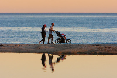 Jogging family on the beach near Stern's Wharf