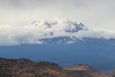 Mount Shasta is 14,179 feet (4,322 m)  It is the second highest peak in the Cascades and the fifth highest in California