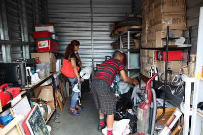 A young couple looking through one of the many storage units operated by JIT.