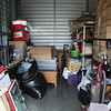 A storage locker full of goods waiting to be taken by youths just getting started in their first home/apartment.