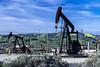 Oi8l pumpers in the oil fields near Taft, California, USA.