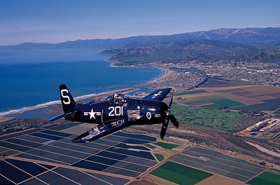 "F8F-2 ""Bearcat"" fighter, Southern Wing of the Commemorative Air Force based in Camarillo, flies over the Oxnard Plain and Ventura County coastline"