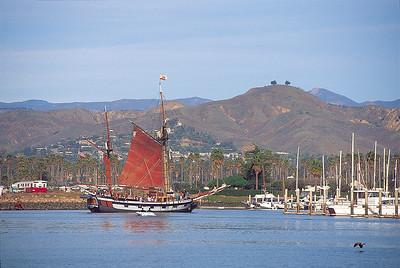 Two Tree Hill viewed from Ventura Harbor with Tallship Hawaiian Chieftain entering harbor