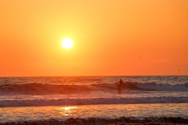Surfing Sunset Waves