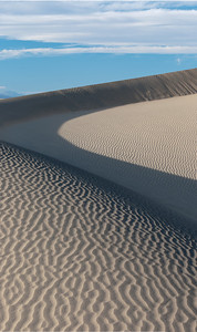 Mesquite Flats Sand Dunes in afternoon light with the Armagoa Range, Death Valley National Park, CA.