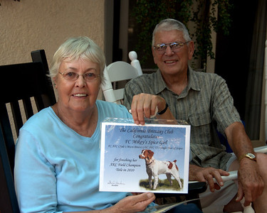 Carolyn and Jerry Cape with their new FC certificate for Spice