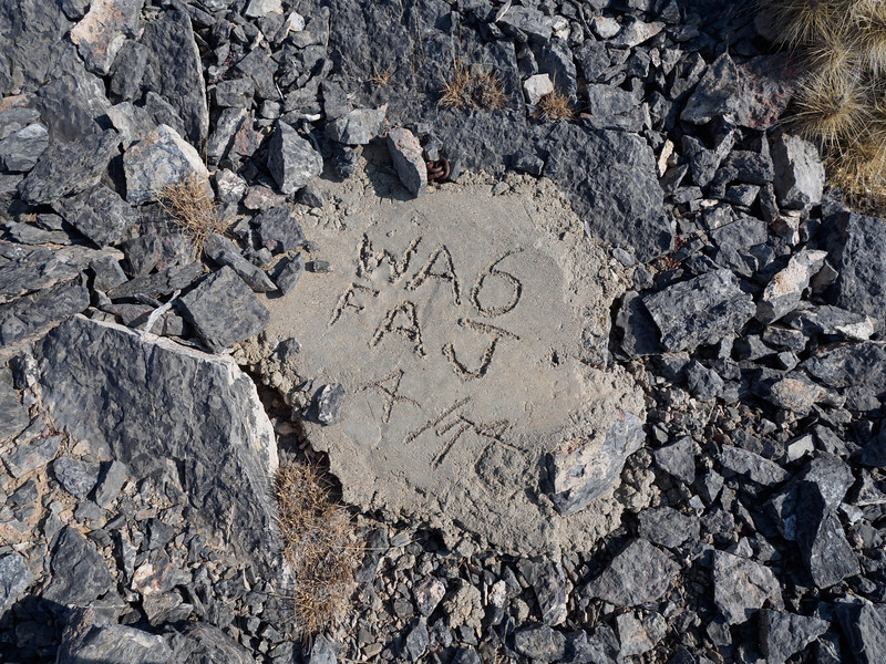 Evidence of former hikers along the ridge - someone carried up some cement in 1974 .