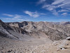 Looking down at the dry small lake as I head up toward Basin's summit