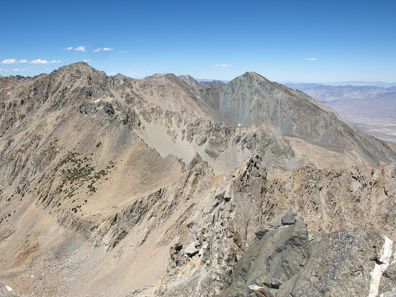 Black Mountain and Mount Mary Austin. Mary Austin is the grey colored peak right of center.  Black is on the far left side of the photo.