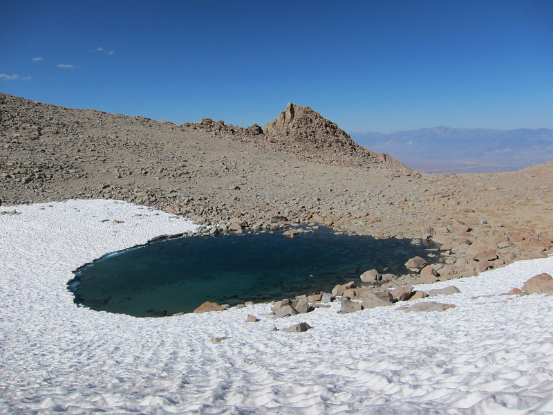 Looking back at the lake on the east side of Lamarck Col.  White Mountain is in the distance across the Owens Valley.