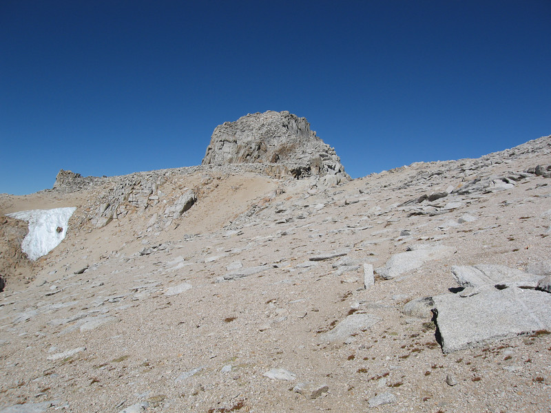 Heading for the big block of a summit.